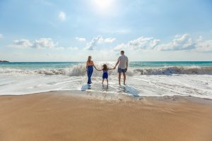 A family of 3 on the beach at the outer banks in NC - Things to do with the kids in outer banks